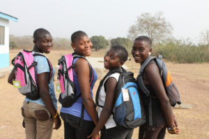 Forgive, Lydia, Peace, and Patience wearing their new backpacks last year.