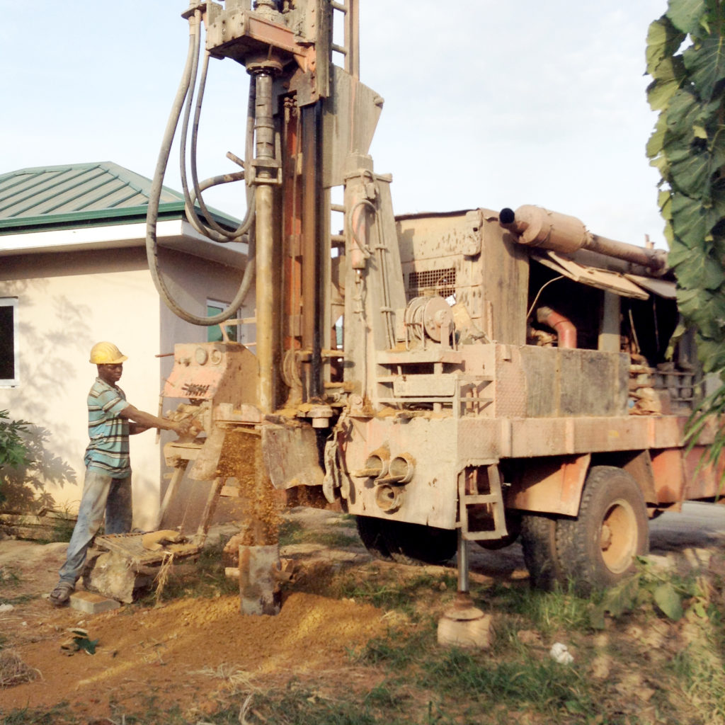 A borehole was dug 180 feet into the ground to reach water.