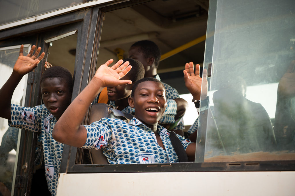 Felix and Johannes wave good-bye as they make the journey to school.