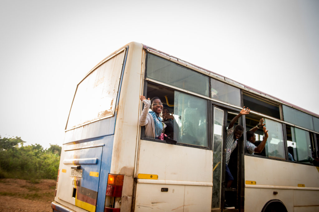 Doris bids farewell to the Care Center as the bus pulls away.